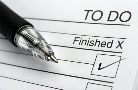 Closeup image of notepad with pen.